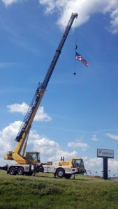 Yellow Hohenshilt Crane with American Flag